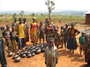 Families arrange their pots for inspection