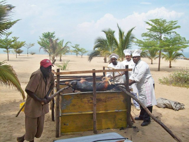 Pig-grilling on the beach of Lake Tanganyika