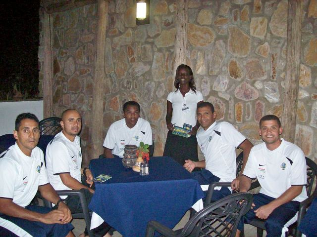 Evelyn, Hotel staff person, with some of the players.  The staff were thrilled to have the players staying at the hotel.