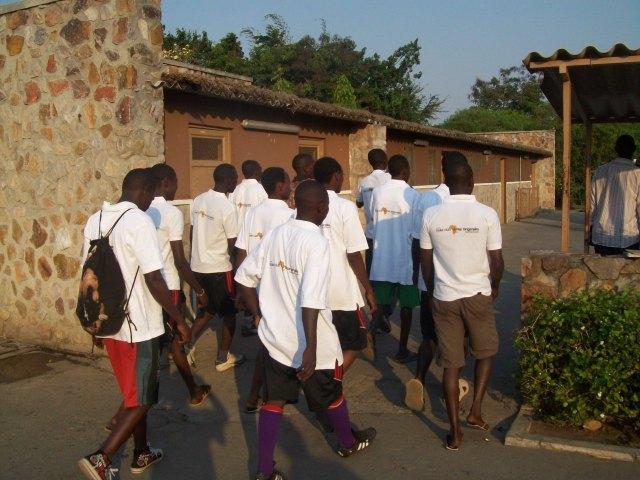 Kajaga team members entering, with Hotel logo shirts