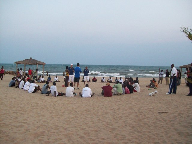 The boys were organized on the beach into a circle, for a lecture and then a series of training exercises