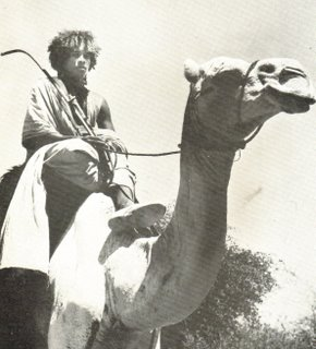 Beja youth and camel