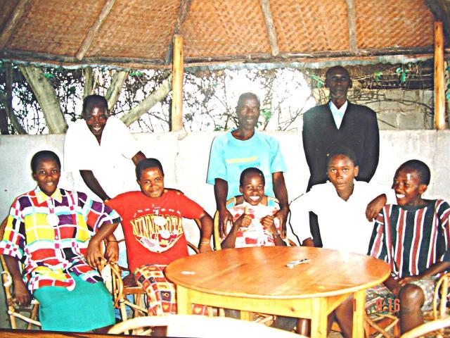 Evonne, on left, with her father behind her and future father-in-law standing at the extreme right. Her sister, brothers and a cousin are next to her.
