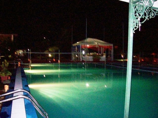 A pivilion in the middle of the swimming pool for the bride and groom, who sat facing the guests