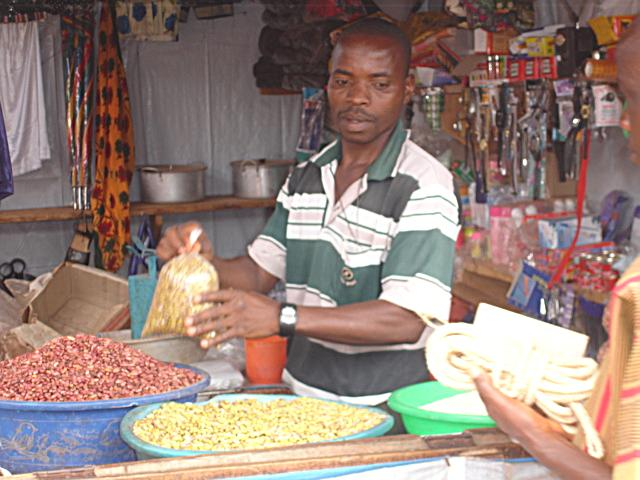 Red and yellow beans for sale in a rural market stall