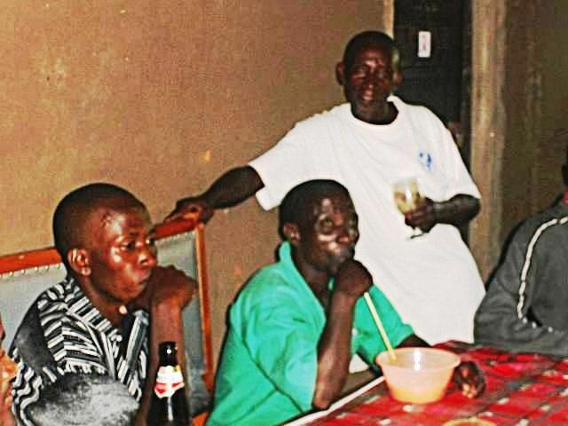 village folk enjoying millet beer and bottled beer in the local caberet.