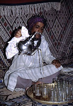 While this tea pouring ceremony is being performed in Morocco by a Touareg, it is exactly as it is performed across North Africa and in the Middle East - and by Muhammed.  Source:  Royal Geographic Society