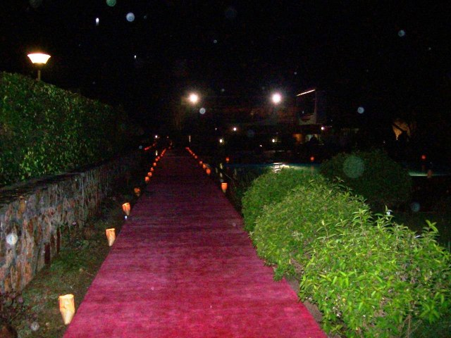 Red carpets and candles leading to the ceremony