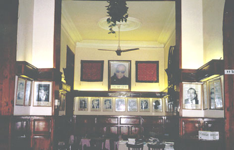 Interior of the Café Riche; photos of past luminaries line the walls.  Source: ambassidors.net