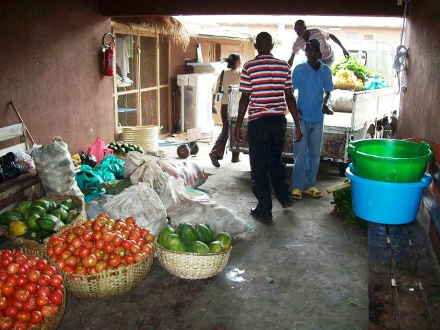 Fresh produce is delivered by different dealers three or four times a week.  Here, it is weighed and sorted