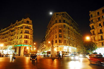 Midan Talaat Harb.  For a time, I took a room in an Italian pension located on the top floor of the building straight ahead.  I enjoyed it very much.  Source:  Wikipedia