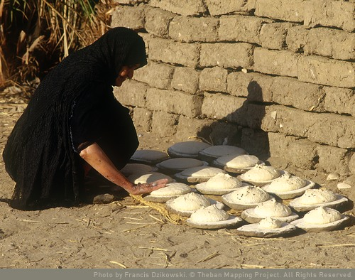 Woman patting out loaves to rise. Thebes Mapping Project