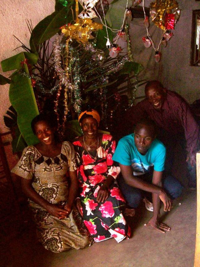 It is now against the law in Burundi to cut down trees for Christmas, and so a tree was made using palm fronds and banana leaves.  There is no electricy in the village, the lights on this tree were strung up just for decoration.