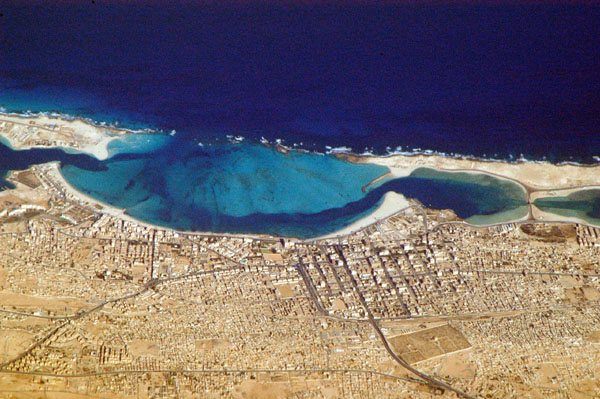 An areal shot of Mersa Matruh and the beach.  Since pharaonic times this areas offered the only protected bay and deep water for vessels and contains several archaeological sites - as well as remains from the Second World War when General Rommel encamped in the area, to be driven out by Allied Forces.  Source - casablanca 146