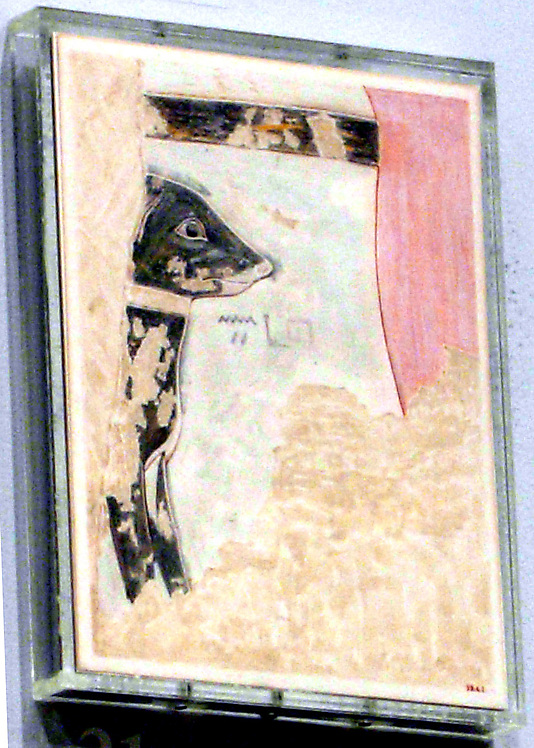 'Hbny' ('Ebony'), pet puppy of Thutmose III, 18th. Dynasty, 1473-1458, resting under the pharoah's chair.  Tomb painting reproduced by  Nina de Garis Davies.  Source: Met. Museum