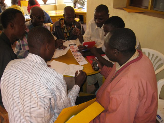 One of the interdisciplinary teams discussing a FAMACHA card.  A training course with techniciens, vets, vet. tecks, extension workers and lead farmers in improved goad husbandry supported by Lutheran     World Services, eastern Burundi.
