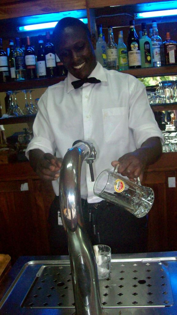 Bodo, head barman, prepares a draft beer.  He's quite happy because he was married just over a week agol