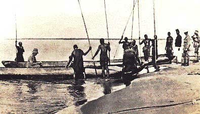 Germans at Kajaga.  The tongue of land behind the boat is part of the Rusizi Wetlands.  Source: Les Barundi, by Hans Meyer