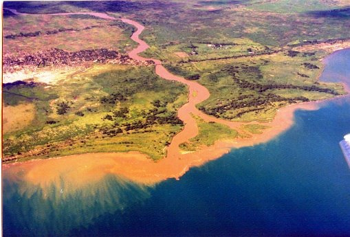 Rusizi river and wetlands, located just to the left of the above areal picture.-  The little town of Gatumba is located just to the left of the river.  I took this and the above areal photo from a WFP plane.