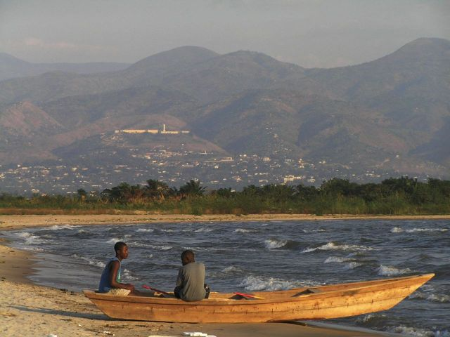 Fishermen  in front of the Hotel, with Bujumbura in the background.  The ancient college of the Jesuits sits above the city, atop