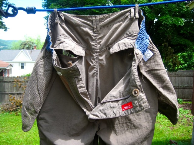 Drying loops on garments are useful.  Or you culd also just use the belt loops.  Source> http://savageminds.org/2014/04/27/fieldwork_clothes_ii/
