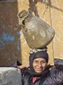 Most rural areas of Egypt now have standpipes where water can be collected and carried to the homes.  Traditional methods of collecting water from nearby canals and transporting it home are now quite rare. - Source: Egypt (first batch)
