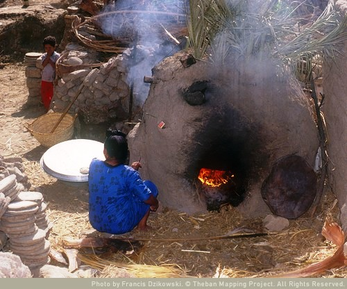 At the mud brick oven, which is fueled by cotton branches and other crop leavings, many of which have been stored on the roof - or may be purchased.  Source - Susan Weeks, Theban Mapping Project