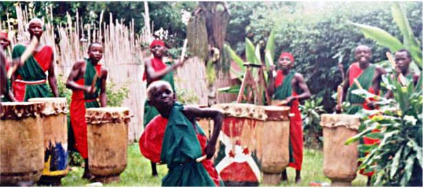 Members of the village drummers' society come to visit and perform.