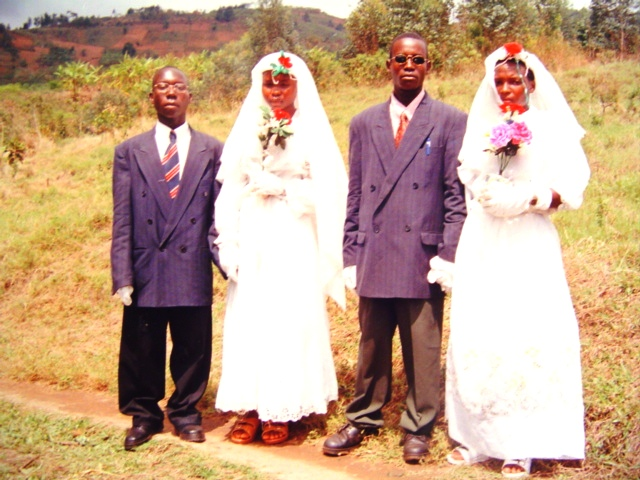 Tarsus and his bride with his good friend just after their wedding in Bujumbura Rural.  Being serious in ceremonial photos is necessary.