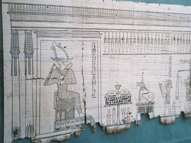 Papyrus on which segments of the Book of the Dead are written, together with drawings - here, Osiris overseeing the crucial act of weighing the heart of the deceased.  Source - Wikipedia