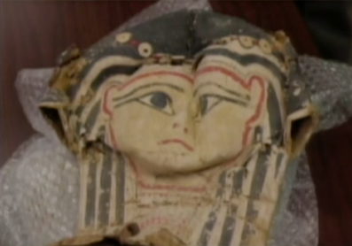 Screen shot of mummy mask (taken from video of Josh McDowell, ricecjones weeblyl.com Source - 'Faces and Voices'